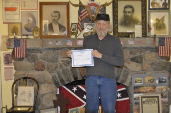 Prospect House Founder Jay Johnson with Archives Grant certificate.